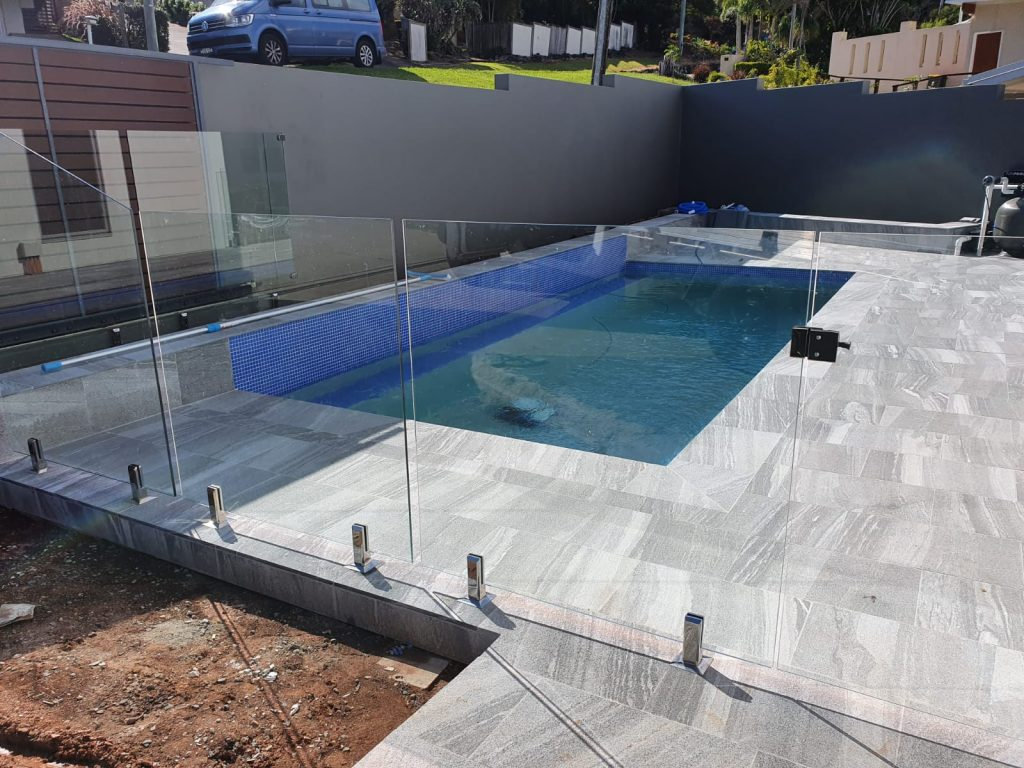 These blue mosaic tiles really pop against the grey surround tiles perfectly! For the best pool builders Gold Coast has on offer, count on Cozy Pools!